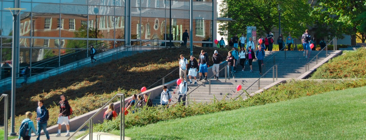 Students walk along the steps in front of University Pavilion.
