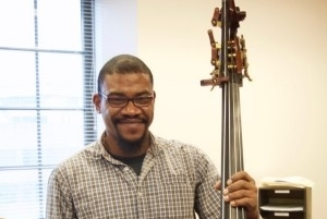 Maurice Todd poses with his double bass instrument.